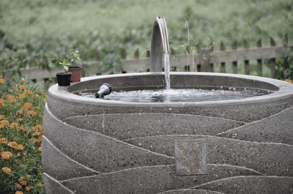 Slider-Arbeiten-Brunnen-aus-Beton-B